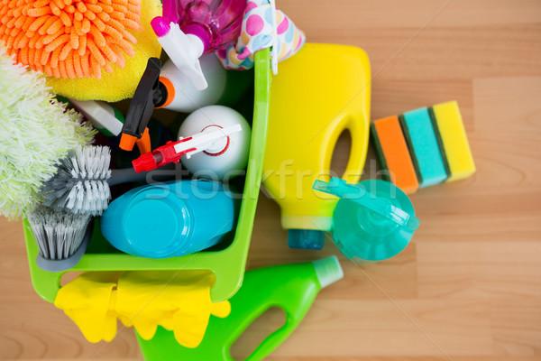 Overhead view of spray bottles and cleaning equipment in bucket Stock photo © wavebreak_media