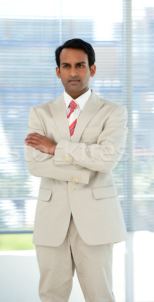 Stock photo: Confident ethnic businessman with folded arms