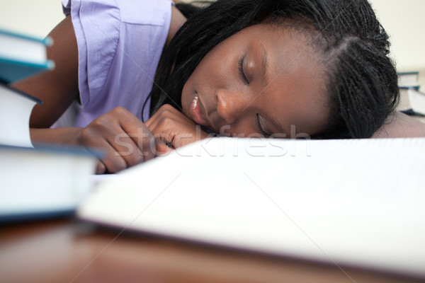 Exhausted woman sleeping while studying  Stock photo © wavebreak_media