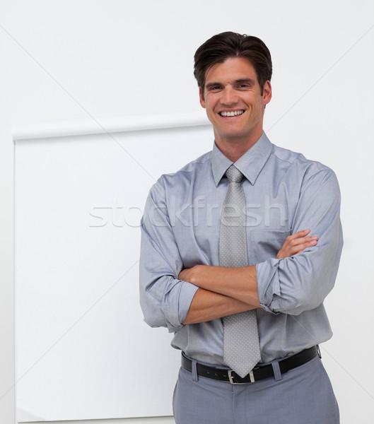 улыбаясь бизнесмен сложенный оружия совета презентация Сток-фото © wavebreak_media