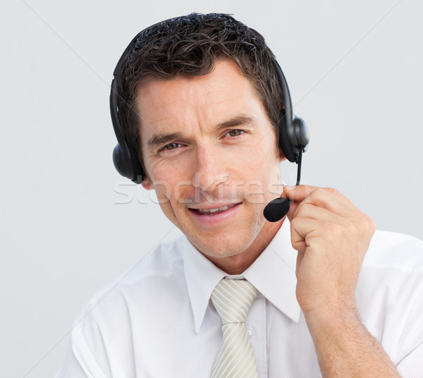 Portrait of an attractive businessman working in a call center Stock photo © wavebreak_media