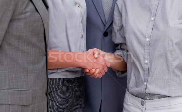 Close-up of a fortunate businessteam closing a deal Stock photo © wavebreak_media