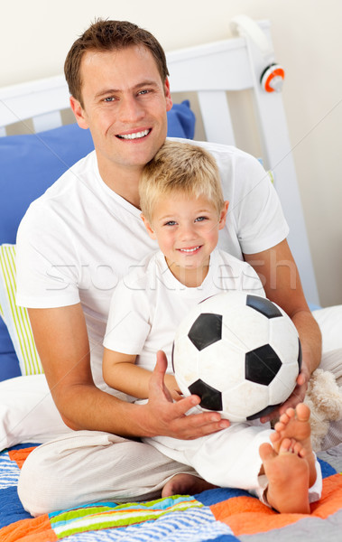Close-up of a little boy and his father playing with a soccer ball Stock photo © wavebreak_media