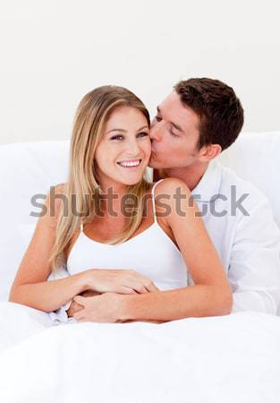 Caring man kissing his laughing wife Stock photo © wavebreak_media