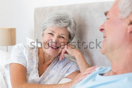 Smiling senior patient sitting on a wheelchair talking with her doctor Stock photo © wavebreak_media
