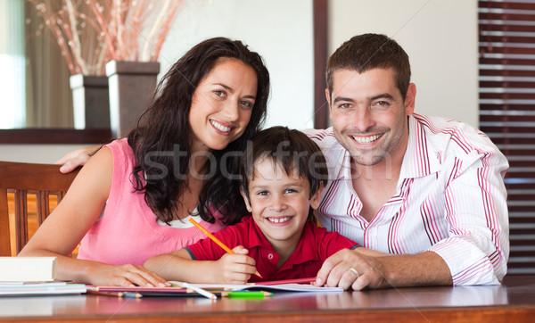 Lovely couple helping his son for homework Stock photo © wavebreak_media