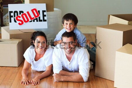 Happy family lying on floor after buying new house Stock photo © wavebreak_media