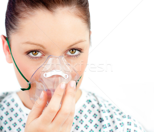 Close-upf of ill woman with a mask looking at the camera against white background Stock photo © wavebreak_media