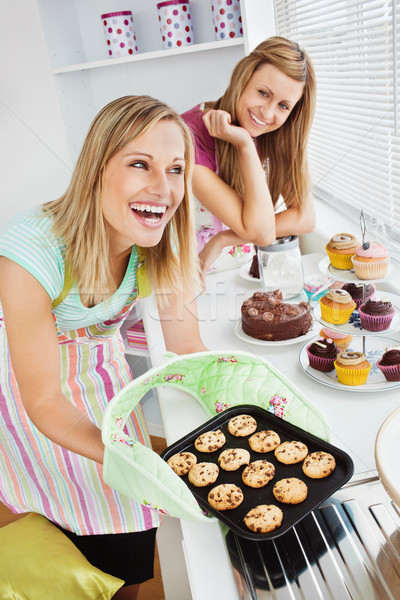 Laughing woman baking together in the kitchen Stock photo © wavebreak_media