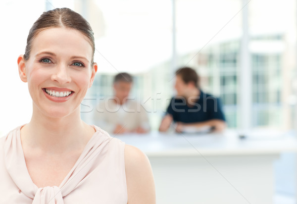 Smiling businesswoman looking at the camera Stock photo © wavebreak_media