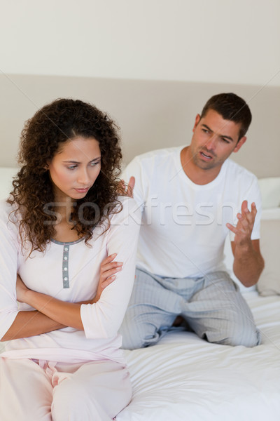 Young couple having a dispute on the bed at home Stock photo © wavebreak_media