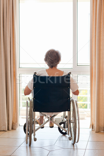 Mature woman in her wheelchair with her back to the camera  Stock photo © wavebreak_media