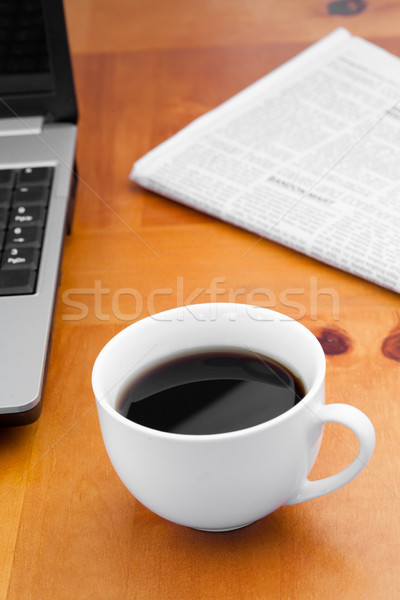 A cup of coffee with a laptop and a newspaper Stock photo © wavebreak_media