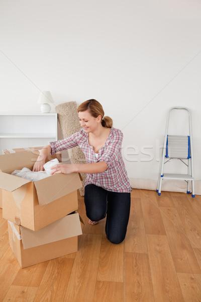 Beautiful blond-haired woman preparing to move house  Stock photo © wavebreak_media