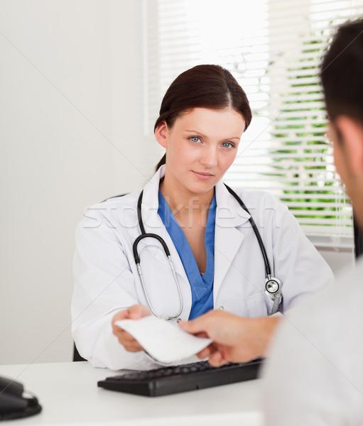 A kind female doctor is giving a patient a prescription Stock photo © wavebreak_media