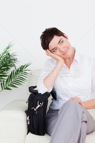 Hermosa mujer de negocios bolsa sala de espera mujer flor Foto stock © wavebreak_media