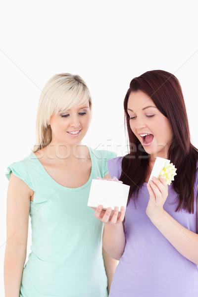 Blond young woman gifting her friend in a studio Stock photo © wavebreak_media