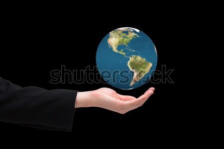 Feminino mão planeta globo Foto stock © wavebreak_media