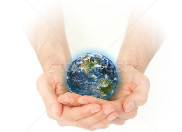 Férfias kezek tart Föld fehér víz Stock fotó © wavebreak_media