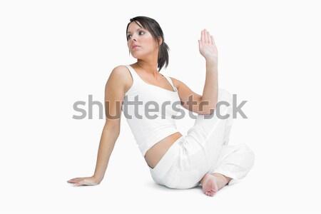 Portrait of a woman in the Ardha Matsyendrasana position against a white background Stock photo © wavebreak_media