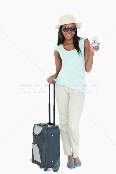 Smiling young woman making holidays abroad against a white background Stock photo © wavebreak_media