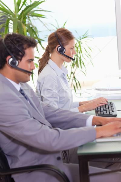 Jovem call center trabalhando outro tecnologia teclado Foto stock © wavebreak_media