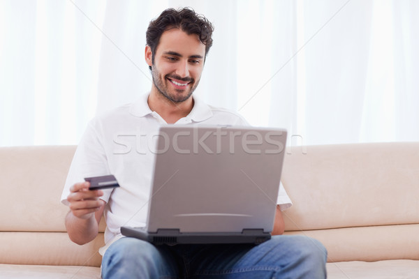Man buying online in his living room Stock photo © wavebreak_media