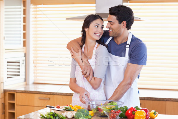 Lovely young couple posing in their kitchen Stock photo © wavebreak_media