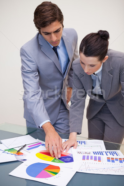 Young consultant and customer looking at statistics Stock photo © wavebreak_media