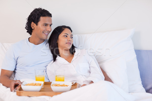 Young couple having breakfast in the bed Stock photo © wavebreak_media