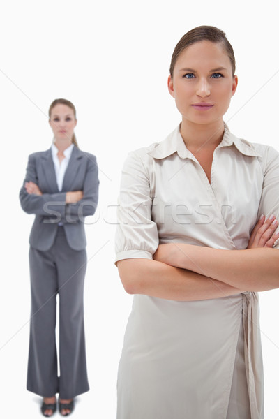 Stock photo: Portrait of serious businesswomen posing against a white background