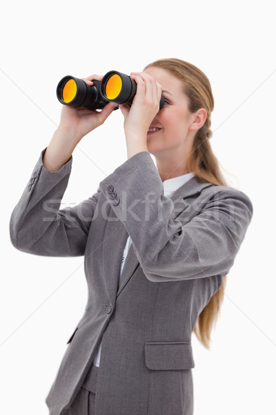 Side view of bank employee with spyglasses against a white background Stock photo © wavebreak_media
