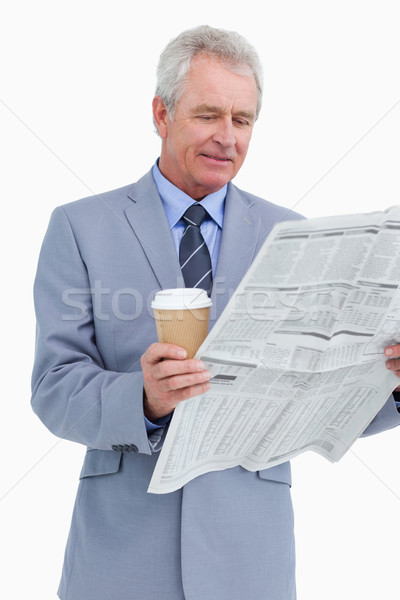 Mature tradesman with news paper and paper cup against a white background Stock photo © wavebreak_media