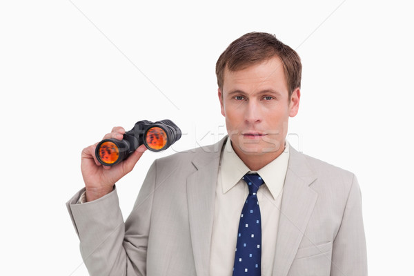 Businessman with spy glasses against a white background Stock photo © wavebreak_media