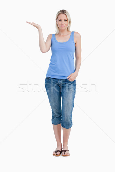 Relaxed blonde woman placing her hand palm up against a white background Stock photo © wavebreak_media