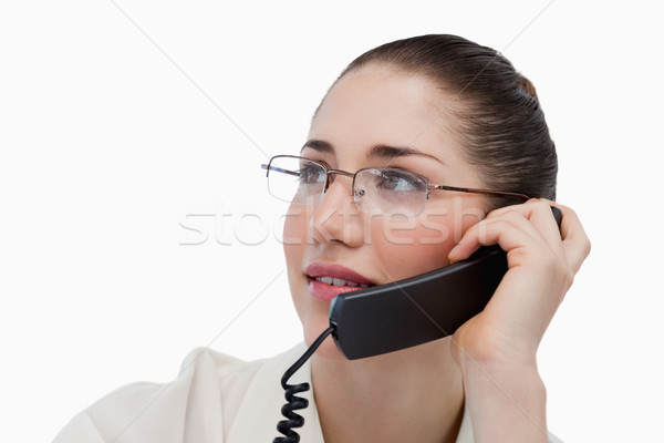 Close up of a secretary making a phone call against a white background Stock photo © wavebreak_media