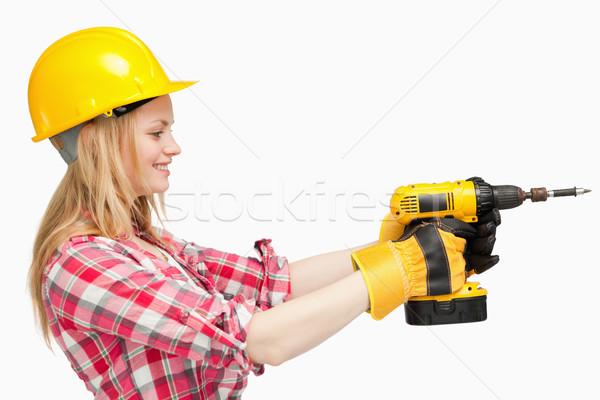 женщину электрических отвертка белый стороны фон Сток-фото © wavebreak_media