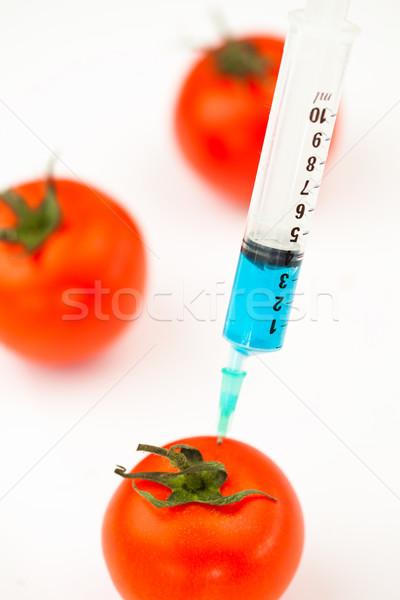 Syringe injecting blue liquid against a white abckground Stock photo © wavebreak_media
