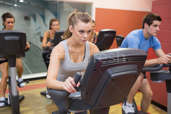 People working out at spinning class in gym Stock photo © wavebreak_media