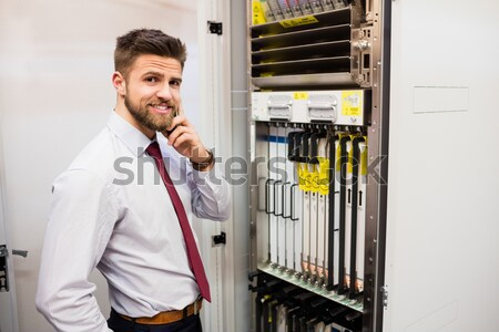 Technician standing next to the data store in hallway Stock photo © wavebreak_media