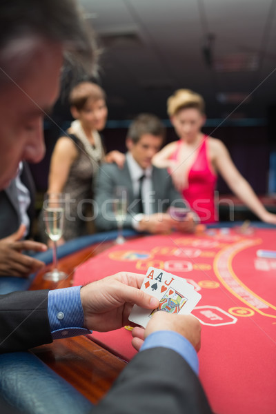 Man looking at his cards in poker game at casino Stock photo © wavebreak_media