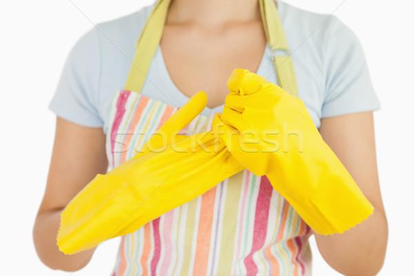 Mulher luvas de borracha avental fundo Foto stock © wavebreak_media