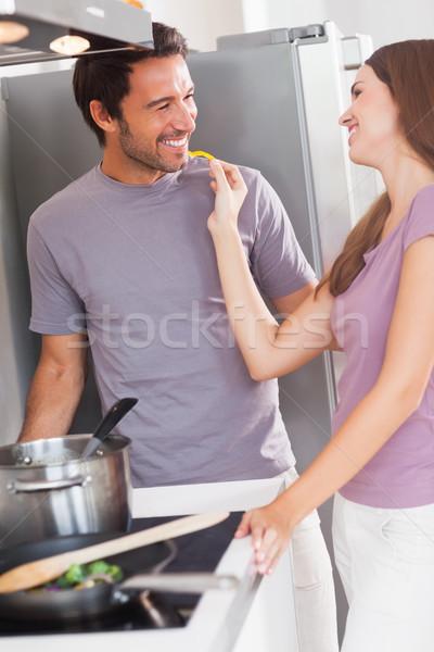 Woman feeding man with a yellow pepper Stock photo © wavebreak_media