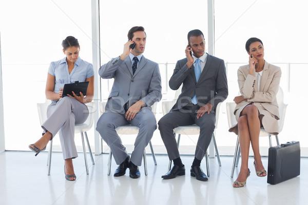 グループ ビジネスの方々  待合室 電話 タブレット オフィス ストックフォト © wavebreak_media