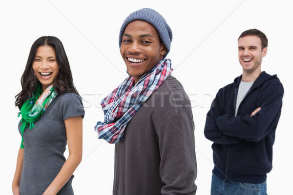 Laughing stylish young people in a row  Stock photo © wavebreak_media