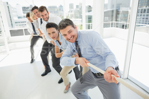 Group of business people pulling rope in office Stock photo © wavebreak_media