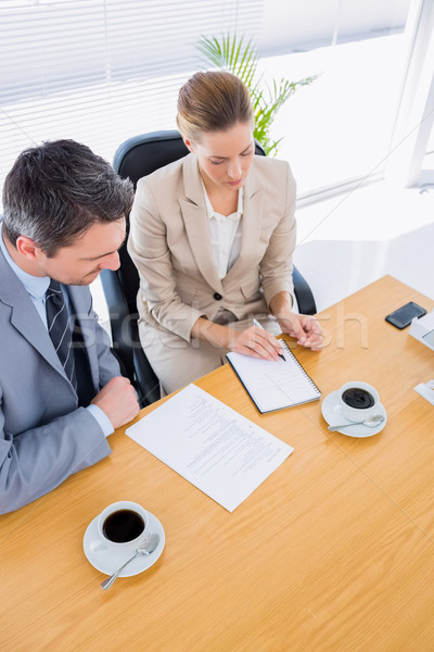 Colegas reunión de negocios joven mujer hombre Foto stock © wavebreak_media