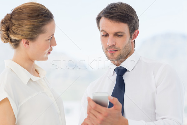 Smartly dressed colleagues looking at mobile phone Stock photo © wavebreak_media