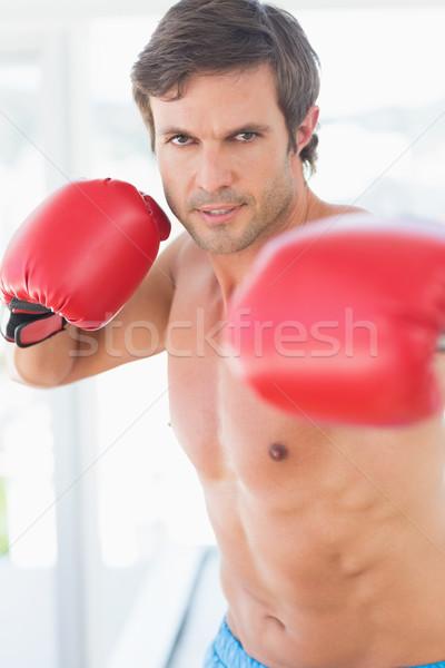 Portrait of a determined male boxer Stock photo © wavebreak_media