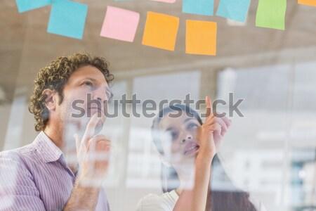 ビジネスの方々  接着剤 ノート ビジネスマン 女性実業家 ガラス ストックフォト © wavebreak_media
